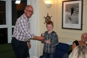 Alex Jiggins receiving the cup for Biggest Catch by a Junior from David Meadway