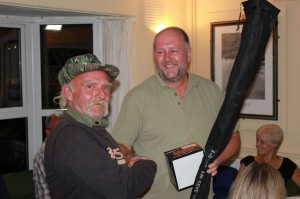 John Sage receiving his prize of a fishing rod and tackle from David, of Brantham Mill Angling